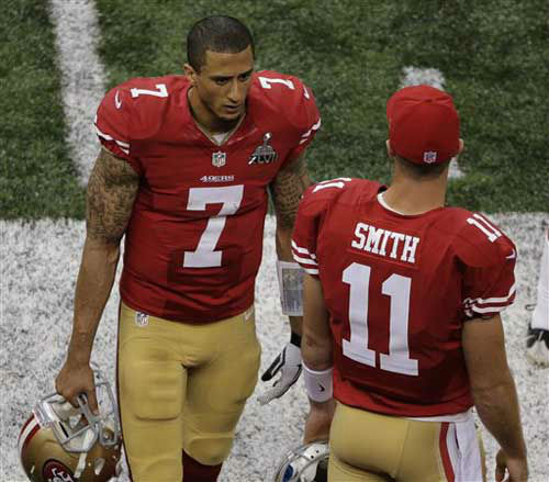San Francisco 49ers quarterbacks Colin Kaepernick &#40;7&#41; and Alex Smith &#40;11&#41; talk on the sideline late in the fourth quarter of the NFL Super Bowl XLVII football game against the Baltimore Ravens, Sunday, Feb. 3, 2013, in New Orleans. &#40;AP Photo&#47;Charlie Riedel&#41; <span class=meta>(Photo&#47;Charlie Riedel)</span>
