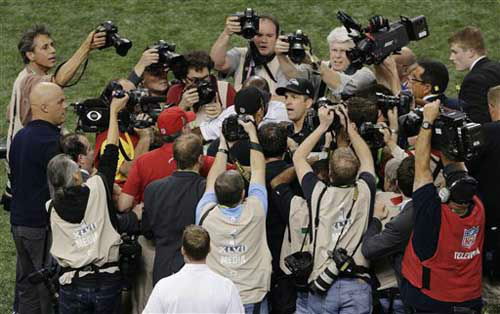 "<div class=""meta ""><span class=""caption-text "">Photographers surround Baltimore Ravens head coach John Harbaugh, right, and San Francisco 49ers head coach Jim Harbaugh as they shake hands after the NFL Super Bowl XLVII football game, Sunday, Feb. 3, 2013, in New Orleans. The Ravens won 34-31. (AP Photo/Charlie Riedel) (Photo/Charlie Riedel)</span></div>"