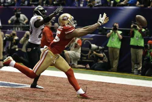 San Francisco 49ers wide receiver Michael Crabtree &#40;15&#41; misses a potential touchdown pass during the second half of the NFL Super Bowl XLVII football game against the Baltimore Ravens, Sunday, Feb. 3, 2013, in New Orleans. &#40;AP Photo&#47;David Goldman&#41; <span class=meta>(Photo&#47;David Goldman)</span>