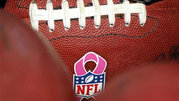 "<div class=""meta ""><span class=""caption-text "">Footballs with a pink ribbon for Breast Cancer Awareness are shown before an NFL football game between the Houston Texans and the Tennessee Titans on Sunday, Oct. 23, 2011, in Nashville, Tenn. (AP Photo/Wade Payne) (AP Photo/ Wade Payne)</span></div>"