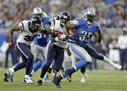 Detroit Lions running back Joique Bell &#40;35&#41; breaks away from the Houston Texans defense for a 23-yard touchdown run during the fourth quarter of an NFL football game at Ford Field in Detroit, Thursday, Nov. 22, 2012. &#40;AP Photo&#47;Paul Sancya&#41; <span class=meta>(Photo&#47;Paul Sancya)</span>