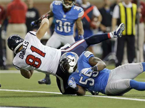 Houston Texans tight end Owen Daniels &#40;81&#41; falls into the end zone over Detroit Lions middle linebacker Stephen Tulloch &#40;55&#41; to score a touchdown during the second quarter of an NFL football game at Ford Field in Detroit, Thursday, Nov. 22, 2012. &#40;AP Photo&#47;Paul Sancya&#41; <span class=meta>(Photo&#47;Paul Sancya)</span>