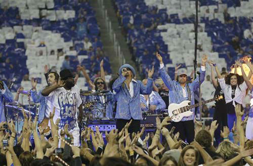 Kid Rock performs during halftime of an NFL football game between the Detroit Lions and the Houston Texans at Ford Field in Detroit, Thursday, Nov. 22, 2012. &#40;AP Photo&#47;Paul Sancya&#41; <span class=meta>(Photo&#47;Paul Sancya)</span>