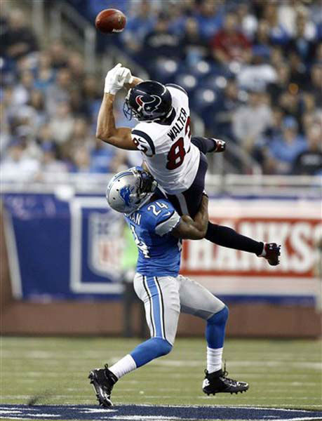Detroit Lions strong safety Erik Coleman &#40;24&#41; breaks up a pass intended for Houston Texans wide receiver Kevin Walter &#40;83&#41; during the third quarter of an NFL football game at Ford Field in Detroit, Thursday, Nov. 22, 2012. &#40;AP Photo&#47;Rick Osentoski&#41; <span class=meta>(Photo&#47;Rick Osentoski)</span>