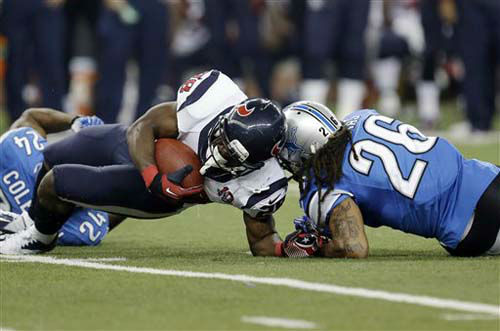 Houston Texans running back Justin Forsett &#40;28&#41; is hit by Detroit Lions free safety Louis Delmas &#40;26&#41; during the third quarter of an NFL football game at Ford Field in Detroit, Thursday, Nov. 22, 2012. &#40;AP Photo&#47;Paul Sancya&#41; <span class=meta>(AP Photo&#47; Paul Sancya)</span>