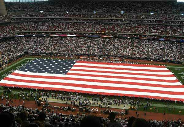 <span class=meta>(The U.S. flag covered the entire field before the Titans-Texans game Sunday)</span>