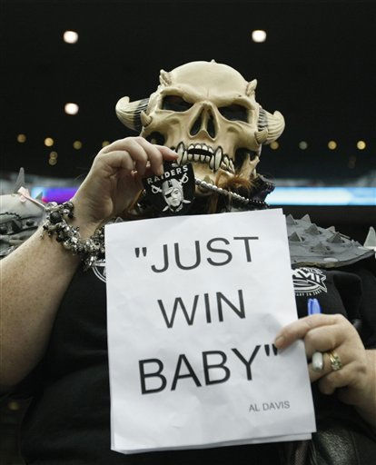 Oakland Raiders fan Kendra Woods displays a quote from late Oakland Raiders owner Al Davis before an NFL football game between the Houston Texans and the Raiders, Sunday, Oct. 9, 2011, in Houston. Davis passed away over the weekend. &#40;AP Photo&#47;Gerald Herbert&#41; <span class=meta>(AP Photo&#47; Gerald Herbert)</span>