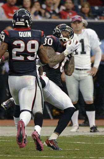 Houston Texans cornerback Jason Allen &#40;30&#41; hauls in an interception as Glover Quin &#40;29&#41; follows and Oakland Raiders&#39; Sebastian Janikowski look on in the second quarter of an NFL football game Sunday, Oct. 9, 2011, in Houston. &#40;AP Photo&#47;Dave Einsel&#41; <span class=meta>(AP Photo&#47; Dave Einsel)</span>