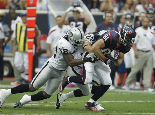 Houston Texans tight end Owen Daniels &#40;81&#41; drags Oakland Raiders  Quentin Groves &#40;52&#41; and  Matt Giordano &#40;27&#41; in the second quarter of an NFL football game Sunday, Oct. 9, 2011, in Houston. &#40;AP Photo&#47;Gerald Herbert&#41; <span class=meta>(AP Photo&#47; Gerald Herbert)</span>