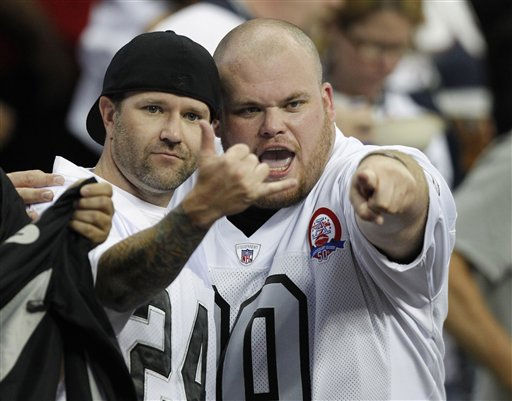 Oakland Raiders fans in the fourth quarter of an NFL football game against the Houston Texans Sunday, Oct. 9, 2011, in Houston. &#40;AP Photo&#47;Gerald Herbert&#41; <span class=meta>(AP Photo&#47; Gerald Herbert)</span>