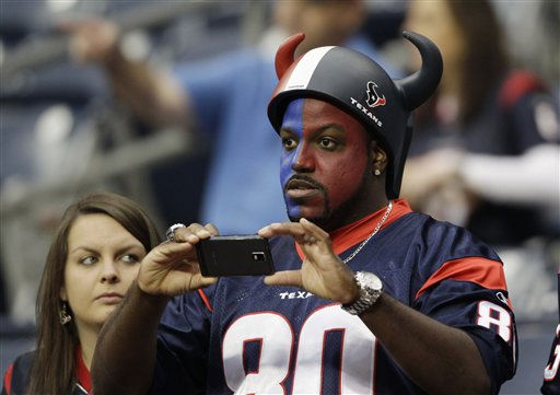 "<div class=""meta image-caption""><div class=""origin-logo origin-image ""><span></span></div><span class=""caption-text"">A Houston Texans fan shoots photos of warm ups before an NFL football game against the Atlanta Falcons Sunday, Dec. 4, 2011, in Houston. (AP Photo/David J. Phillip) (AP Photo/ David J. Phillip)</span></div>"