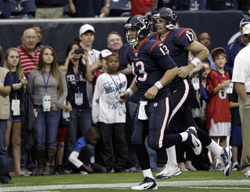 Houston Texans quarterbacks T.J. Yates &#40;13&#41; and Jake Delhomme &#40;17&#41; run down the field before an NFL football game against the Atlanta Falcons Sunday, Dec. 4, 2011, in Houston. &#40;AP Photo&#47;David J. Phillip&#41; <span class=meta>(AP Photo&#47; David J. Phillip)</span>