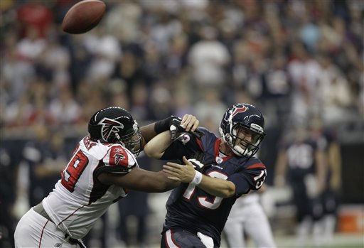 "<div class=""meta ""><span class=""caption-text "">Atlanta Falcons defensive tackle Vance Walker (99) grabs the arm of Houston Texans quarterback T.J. Yates (13) forcing a turnover resulting in a touchdown for the Falsons in first quarter of an NFL football game Sunday, Dec. 4, 2011, in Houston. (AP Photo/David J. Phillip) (AP Photo/ David J. Phillip)</span></div>"