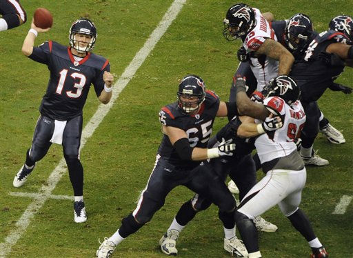 Houston Texans quarterback T.J. Yates &#40;13&#41; and the Atlanta Falcons in the first quarter of an NFL football game Sunday, Dec. 4, 2011, in Houston. &#40;AP Photo&#47;Dave Einsel&#41; <span class=meta>(AP Photo&#47; Dave Einsel)</span>