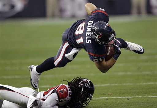 Houston Texans tight end Owen Daniels &#40;81&#41; goes airborne after being tackled by Atlanta Falcons cornerback Dunta Robinson &#40;23&#41; in the first quarter of an NFL football game on Sunday, Dec. 4, 2011, in Houston. &#40;AP Photo&#47;David J. Phillip&#41; <span class=meta>(AP Photo&#47; David J. Phillip)</span>