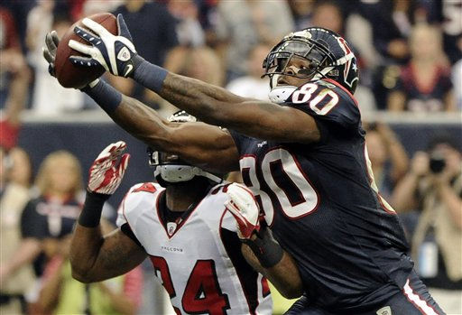 Houston Texans wide receiver Andre Johnson &#40;80&#41; makes the catch for a first down in front of Atlanta Falcons defensive back Dominique Franks &#40;24&#41; in the second quarter of an NFL football game on Sunday, Dec. 4, 2011, in Houston. &#40;AP Photo&#47;Dave Einsel&#41; <span class=meta>(AP Photo&#47; Dave Einsel)</span>