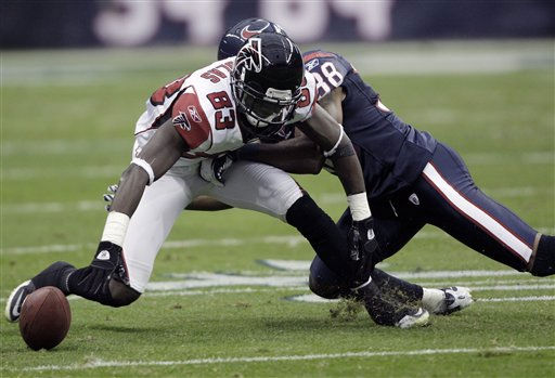 Houston Texans inside linebacker Brian Cushing &#40;56&#41; keeps Atlanta Falcons wide receiver Harry Douglas &#40;83&#41; away from the ball in the first quarter of an NFL football game Sunday, Dec. 4, 2011, in Houston. &#40;AP Photo&#47;David J. Phillip&#41; <span class=meta>(AP Photo&#47; David J. Phillip)</span>