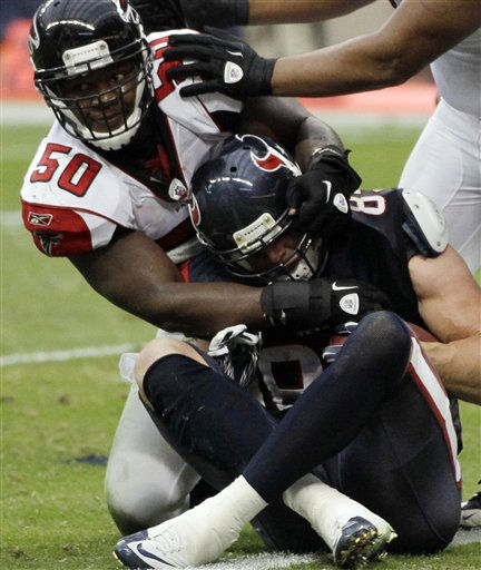 "<div class=""meta ""><span class=""caption-text "">Atlanta Falcons middle linebacker Curtis Lofton (50) tries to pull Houston Texans tight end Joel Dreessen (85) back over the goal line as Dreesen scores a touchdown in the second quarter of an NFL football game on Sunday, Dec. 4, 2011, in Houston. (AP Photo/David J. Phillip) (AP Photo/ David J. Phillip)</span></div>"
