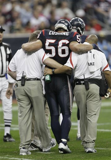 Houston Texans inside linebacker Brian Cushing &#40;56&#41; is helped off the field in the second quarter of an NFL football game against the Atlanta Falcons Sunday, Dec. 4, 2011, in Houston. Cushing did return to the game. &#40;AP Photo&#47;David J. Phillip&#41; <span class=meta>(AP Photo&#47; David J. Phillip)</span>