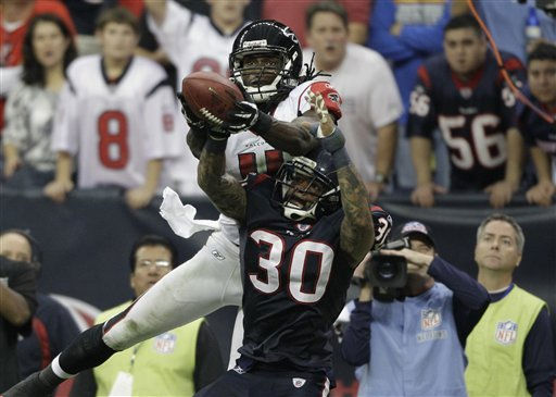 Atlanta Falcons wide receiver Julio Jones &#40;11&#41; and Houston Texans cornerback Jason Allen &#40;30&#41; in the fourth quarter of an NFL football game Sunday, Dec. 4, 2011, in Houston. &#40;AP Photo&#47;David J. Phillip&#41; <span class=meta>(AP Photo&#47; David J. Phillip)</span>