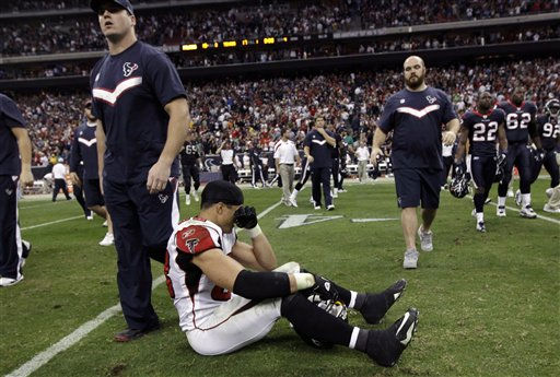 Atlanta Falcons tight end Tony Gonzalez, center, sits on the field after the final play of an NFL football game against the Houston Texans, Sunday, Dec. 4, 2011, in Houston. The Texans won 17-10. &#40;AP Photo&#47;David J. Phillip&#41; <span class=meta>(AP Photo&#47; David J. Phillip)</span>