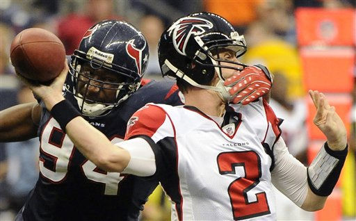 Atlanta Falcons quarterback Matt Ryan &#40;2&#41; is grabbed by Houston Texans defensive end Antonio Smith &#40;94&#41; in the second quarter of an NFL football game on Sunday, Dec. 4, 2011, in Houston. Officials called it a personal foul, roughing the passer, for a 15-yard penalty. &#40;AP Photo&#47;Dave Einsel&#41; <span class=meta>(AP Photo&#47; Dave Einsel)</span>