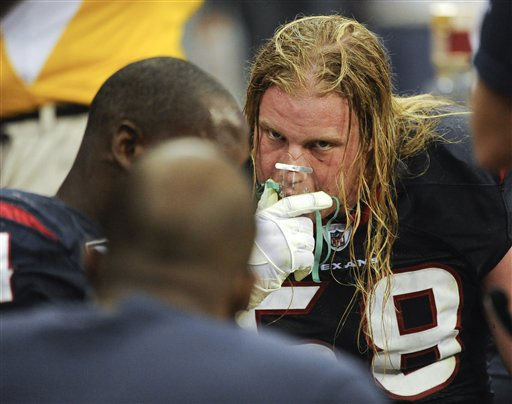 Houston Texans&#39; Brooks Reed takes oxygen in the third quarter of an NFL football game against the Atlanta Falcons, Sunday, Dec. 4, 2011, in Houston. &#40;AP Photo&#47;Dave Einsel&#41; <span class=meta>(AP Photo&#47; Dave Einsel)</span>
