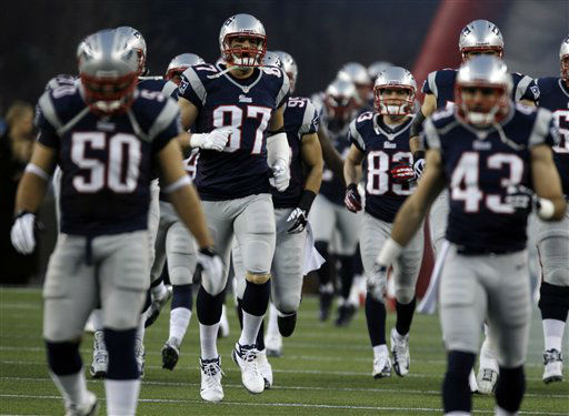 New England Patriots tight end Rob Gronkowski &#40;87&#41; runs onto the field with his teammates before an AFC divisional playoff NFL football game against the Houston Texans in Foxborough, Mass., Sunday, Jan. 13, 2013. &#40;AP Photo&#47;Charles Krupa&#41; <span class=meta>(AP Photo&#47; Charles Krupa)</span>
