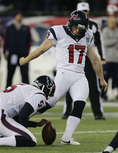 Houston Texans punter Donnie Jones, left holds as Shayne Graham &#40;17&#41; kicks a 27-yard field goal during the first half of an AFC divisional playoff NFL football game against the New England Patriots in Foxborough, Mass., Sunday, Jan. 13, 2013. &#40;AP Photo&#47;Charles Krupa&#41; <span class=meta>(AP Photo&#47; Charles Krupa)</span>