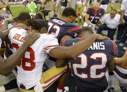 Houston Texans and San Francisco 49ers players pause for a prayer after an NFL preseason football game Saturday, Aug. 18, 2012, in Houston. The Texans beat the 49ers 20-9.   <span class=meta>(AP Photo&#47; Dave Einsel)</span>