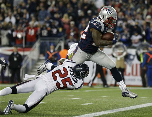 Houston Texans cornerback Kareem Jackson &#40;25&#41; cannot restrain New England Patriots running back Stevan Ridley as he crosses the goal line for an eight-yard touchdown during the second half of an AFC divisional playoff NFL football game in Foxborough, Mass., Sunday, Jan. 13, 2013. &#40;AP Photo&#47;Elise Amendola&#41; <span class=meta>(AP Photo&#47; Elise Amendola)</span>