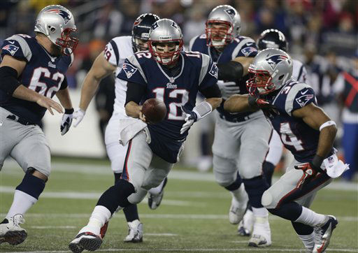 New England Patriots quarterback Tom Brady &#40;12&#41; hands off to Shane Vereen during the first half of an AFC divisional playoff NFL football game against the Houston Texans in Foxborough, Mass., Sunday, Jan. 13, 2013.   <span class=meta>(AP Photo&#47; Charles Krupa)</span>