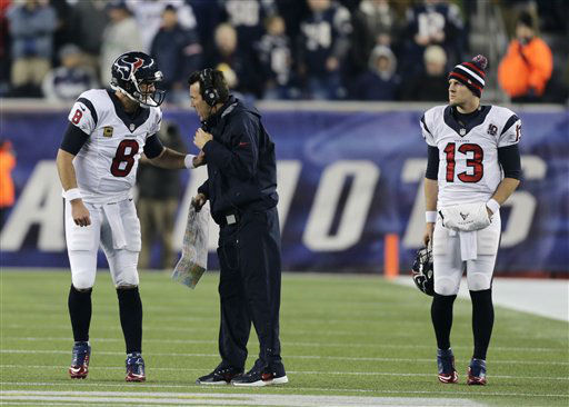 Houston Texans back up quarterback T.J. Yates, right, listens while Matt Schaub talks to head coach Gary Kubiak during the first half of an AFC divisional playoff NFL football game against the New England Patriots in Foxborough, Mass., Sunday, Jan. 13, 2013. &#40;AP Photo&#47;Charles Krupa&#41; <span class=meta>(AP Photo&#47; Charles Krupa)</span>