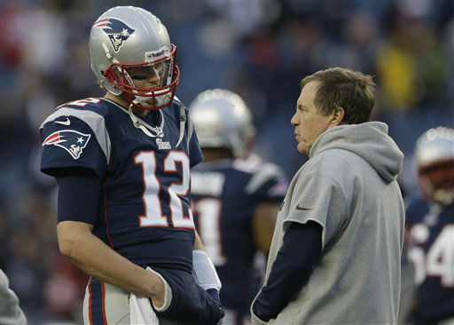 New England Patriots quarterback Tom Brady talks with head coach Bill Belichick before an AFC divisional playoff NFL football game against the Houston Texans in Foxborough, Mass., Sunday, Jan. 13, 2013. &#40;AP Photo&#47;Elise Amendola&#41; <span class=meta>(AP Photo&#47; Elise Amendola)</span>