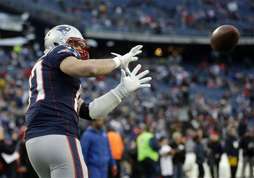 New England Patriots tight end Rob Gronkowski warms up before an AFC divisional playoff NFL football game against the Houston Texans in Foxborough, Mass., Sunday, Jan. 13, 2013. &#40;AP Photo&#47;Elise Amendola&#41; <span class=meta>(AP Photo&#47; Elise Amendola)</span>