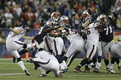 Houston Texans kicker Shayne Graham, left, kicks a 55-yard field goal during the first half of an AFC divisional playoff NFL football game against the New England Patriots in Foxborough, Mass., Sunday, Jan. 13, 2013.   <span class=meta>(AP Photo&#47; Elise Amendola)</span>