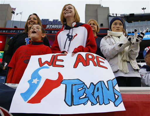 From left, Lisa Peters, Garrett Peters, Brenda Bryne and Lynde Peters from Houston, watch teams warm up before an AFC divisional playoff NFL football game between the New England Patriots and the Houston Texans in Foxborough, Mass., Saturday, Jan. 12, 2013. &#40;AP Photo&#47;Stephan Savoia&#41; <span class=meta>(AP Photo&#47; Stephan Savoia)</span>