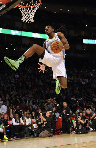 Kenneth Faried of the Denver Nuggets makes an attemp at the slam dunk contest during NBA All-Star Saturday Night basketball Saturday, Feb. 16, 2013, in Houston.   <span class=meta>(AP Photo&#47; Pat Sullivan)</span>