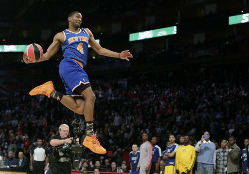 James White of the New York Knicks competes in the slam dunk competition during NBA All-Star Saturday Night basketball Saturday, Feb. 16, 2013, in Houston.  <span class=meta>(AP Photo&#47; Eric Gay)</span>