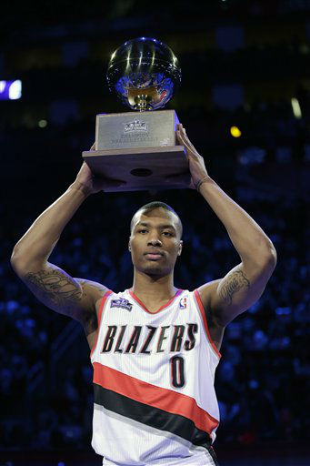 Damian Lillard of the Portland Trail Blazers holds up his trophy after winning the skills challenge competition during NBA All-Star Saturday Night basketball Saturday, Feb. 16, 2013, in Houston.   <span class=meta>(AP Photo&#47; Eric Gay)</span>