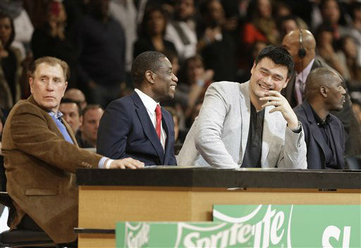 Former Houston Rockets coach Rudy Tomjanovich, left, and players Dikembe Mutombo and Yao Ming, right, judge the slam dunk contest during NBA All-Star Saturday Night basketball Saturday, Feb. 16, 2013, in Houston.   <span class=meta>(AP Photo&#47; Pat Sullivan)</span>