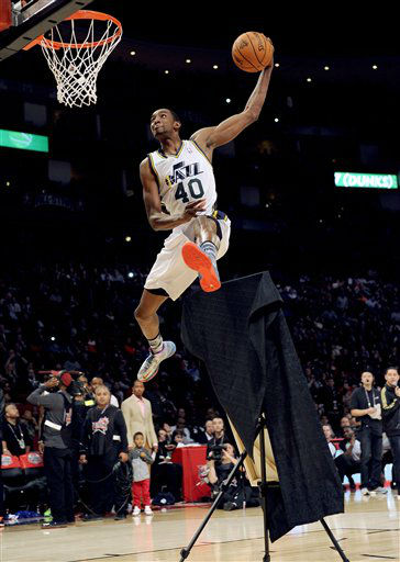 Jeremy Evans of the Utah Jazz leaps over a portrait of himsef at the slam dunk contest during NBA All-Star Saturday Night basketball Saturday, Feb. 16, 2013, in Houston.  <span class=meta>(AP Photo&#47; Pat Sullivan)</span>