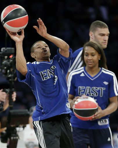 Former NBA player Muggsy Bogues and Indiana Fever&#39;s Tamika Catchings participate in the skills challenge during NBA All-Star Saturday Night basketball in Houston on Saturday, Feb. 16, 2013.   <span class=meta>(AP Photo&#47; Eric Gay)</span>