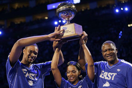 Chris Bosh of the Miami Heat, Swin Cash of the Chicago Sky and former NBA basketball player Dominique Wilkins celebrate winning at the skills challenge during NBA All-Star Saturday Night, Saturday, Feb. 16, 2013, in Houston.   <span class=meta>(AP Photo&#47; Eric Gay)</span>