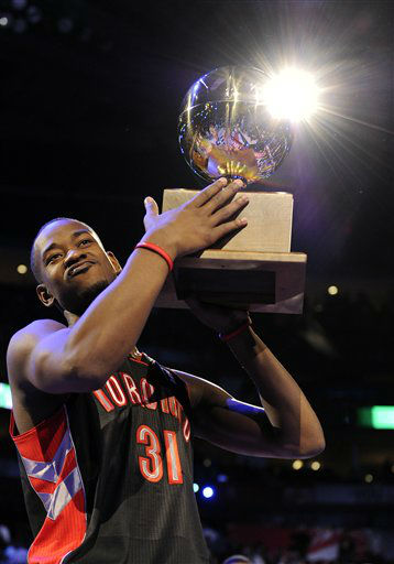 Terrence Ross of the Toronto Raptors holds up the trophy after winning at the slam dunk contest during NBA All-Star Saturday Night basketball Saturday, Feb. 16, 2013, in Houston. &#40;AP Photo&#47;Pat Sullivan&#41; <span class=meta>(AP Photo&#47; Pat Sullivan)</span>