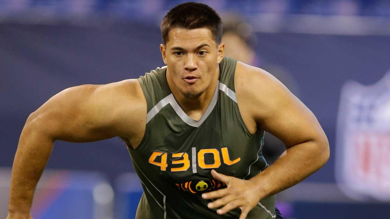 UCLA offensive lineman Xavier SuA-Filo runs a drill at the NFL football scouting combine in Indianapolis, Saturday, Feb. 22, 2014. (AP Photo/Michael Conroy)
