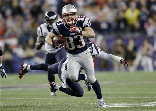 New England Patriots wide receiver Wes Welker &#40;83&#41; runs from Houston Texans defensive back Quintin Demps &#40;27&#41; during the second quarter of an NFL football game in Foxborough, Mass., Monday, Dec. 10, 2012. &#40;AP Photo&#47;Elise Amendola&#41; <span class=meta>(AP Photo&#47; Elise Amendola)</span>