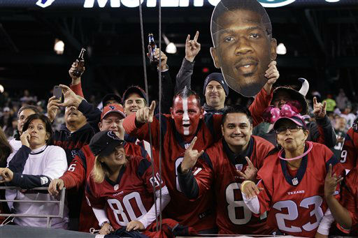 "<div class=""meta ""><span class=""caption-text "">Houston Texans fans cheer while holding up a photo of wide receiver Andre Johnson (80)before an NFL football game between the New York Jets and the Houston Texans Monday, Oct. 8, 2012, in East Rutherford, N.J. (AP Photo/Kathy Willens) (AP Photo/ Kathy Willens)</span></div>"