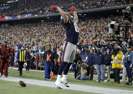 New England Patriots tight end Aaron Hernandez &#40;81&#41; celebrates his touchdown catch against the Houston Texans during the second quarter of an NFL football game in Foxborough, Mass., Monday, Dec. 10, 2012. &#40;AP Photo&#47;Elise Amendola&#41; <span class=meta>(AP Photo&#47; Elise Amendola)</span>