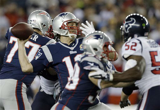 "<div class=""meta ""><span class=""caption-text "">New England Patriots quarterback Tom Brady (12) passes over Houston Texans inside linebacker Tim Dobbins (52) during the first quarter of an NFL football game in Foxborough, Mass., Monday, Dec. 10, 2012. (AP Photo/Elise Amendola) (AP Photo/ Elise Amendola)</span></div>"
